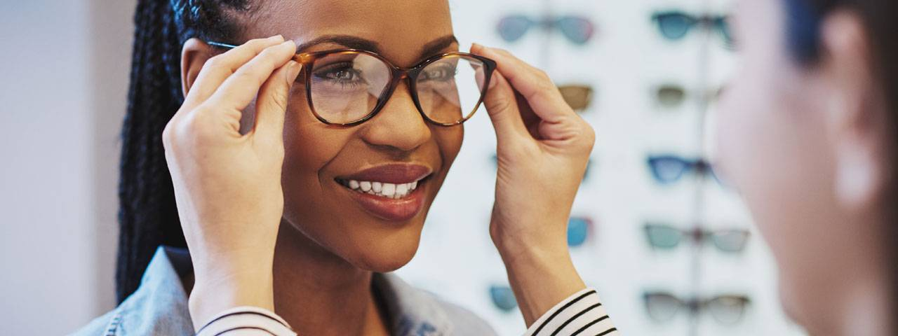 African Woman Trying on Glasses 1280x480